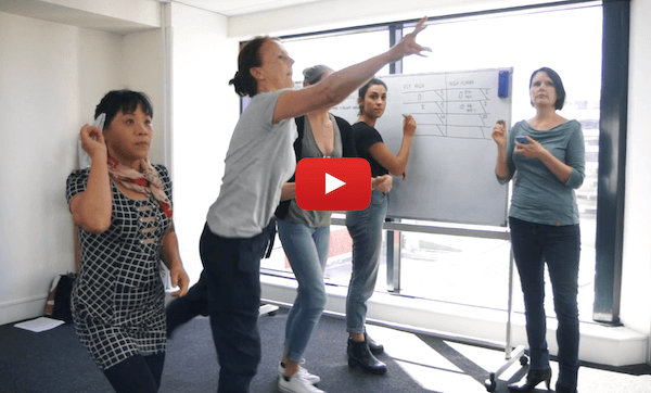 Playing the paper plane game in the Agile Professional Foundation. Click to preview the course on YouTube.